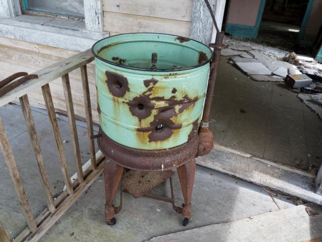 Bullet riddled rusting washtub
